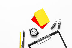 Set to judge competition. Yellow and red cards, stopwatch, whistle, pad on white background top view copyspace Royalty Free Stock Photo