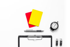 Set to judge competition. Yellow and red cards, stopwatch, whistle, pad on white background top view Royalty Free Stock Photos