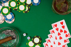 Set to playing poker with cards and chips on green background Royalty Free Stock Photography