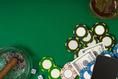 Set to playing poker with cards and chips on green background Royalty Free Stock Images