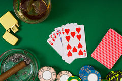 Set to playing poker with cards and chips on green table, top view Stock Images