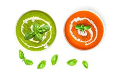 Set of Tomato and Spinach soup with cream in a bowl with basil leaves  isolated on white background, top view. Close up. Royalty Free Stock Images