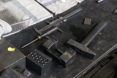 Set of tool in dark grungy workshop garage, hammer. Screwdriver Stock Images
