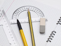 Set of tools. Protractor, pen, pencil, rules and workbook page Royalty Free Stock Photo