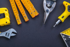 Set of tools adjustable wrench tapeline wooden Royalty Free Stock Images