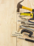 Set of tools as labour day background. Set of tools on wood as labour day background royalty free stock images