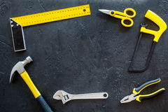 Set of tools for build and repair house on dark background top view frame mock-up. Set of tools for build and repair house on dark desk background top view frame Royalty Free Stock Photography