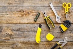 Set of tools for build and repair house on wooden background top view mock-up Royalty Free Stock Image