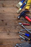 Set of tools for building and treatment on wooden background: hammer, measuring tape, drill. Royalty Free Stock Image