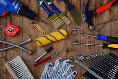 Set of tools for building and treatment on wooden background: hammer, measuring tape, drill. Stock Photos