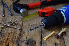 Set of tools for building and treatment on wooden background: hammer, measuring tape, drill Stock Photo