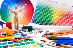 A set of tools for creative art work with abstract colored palette guide. Royalty Free Stock Photo