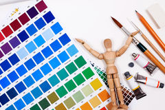 A set of tools for creative art work with abstract colored palette guide. Royalty Free Stock Image