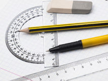 Set of tools for drawing. Protractor, pen, pencil, rules and workbook page Royalty Free Stock Image