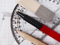 Set of tools for drawing. Protractor, pen, pencil, rules and workbook page Royalty Free Stock Images