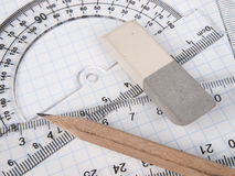 Set of tools for drawing. Protractor,  pencil, rules and workbook page Stock Photo