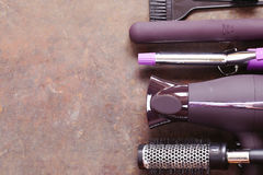 Set the tools hairdressers - hair dryer, curling iron Royalty Free Stock Photos