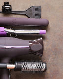 Set the tools hairdressers - hair dryer, curling iron Stock Photography