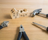 Set of tools and handmade wood house toy. Stock Photo