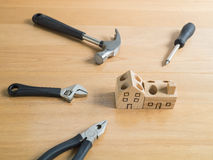 Set of tools and handmade wood house toy. Royalty Free Stock Photo