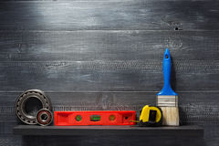 Set of tools and instruments on  shelf Stock Photos