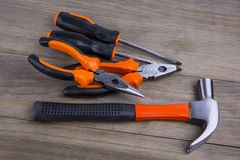 Set of tools. And instruments on wooden background. Different kinds of tools for household chores. Home repairs stock photography