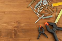 Set of tools and instruments on wooden background. Different kinds of tools for household chores. Home repairs. Father's Day. Royalty Free Stock Image