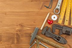 Set of tools and instruments on wooden background. Different kinds of tools for household chores. Home repairs. Father's Day. Set of tools and instruments on royalty free stock photo