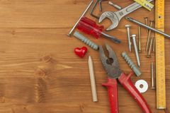 Set of tools and instruments on wooden background. Different kinds of tools for household chores. Home repairs. Father's Day. Set of tools and instruments on royalty free stock images