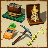 Set of tools miner and gift figurines Royalty Free Stock Photos