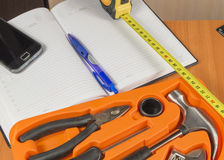set of tools and  notebook. A place for your text Stock Images