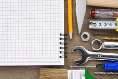 Set of tools and notebook on wood Stock Photo