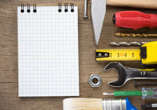 Set of tools and notebook on wood Royalty Free Stock Photography
