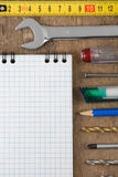 Set of tools and notebook on wood Stock Image
