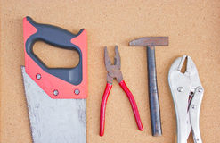Set of tools. Set of tools over cork board Stock Photos