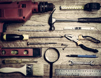 Set of tools over a wood background Stock Image