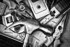 Set of tools over a wood panel Royalty Free Stock Image