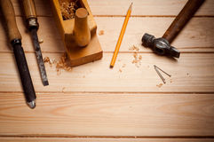 Set of tools over a wood panel with space for text Royalty Free Stock Images