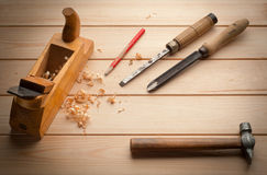 Set of tools over a wood panel with space for text Stock Images