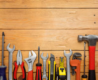 Set of tools over a wood panel stock photo