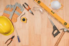 Set of tools over a wood panel with space for text.  royalty free stock photos