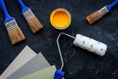 Set of tools for painting on black stone desk background top view Stock Photography