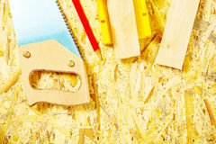 Set of tools on plywood board Royalty Free Stock Image