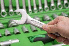 A set of tools for repair in car service - mechanic`s hands, close up. Auto mechanic with working tools for repair and diagnostic. S of cars in the garage car royalty free stock image