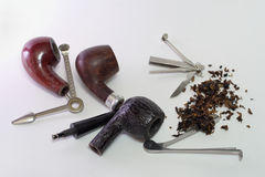 Set of tools for smoking pipes. Dismantled wooden smoking pipes Royalty Free Stock Images