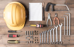 Set tools supplies with blank notebook on wood Royalty Free Stock Photos