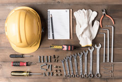 Set tools supplies with blank notebook on wood Stock Images