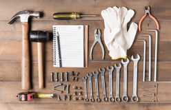 Set tools supplies with blank notebook on wood Royalty Free Stock Image