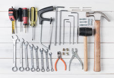 Set of tools supplies on wood background Stock Images