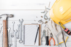 Set of tools supplies on wood background. Stock Images